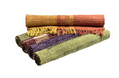 The indian carpets. The multicolored, Indian cotton rugs for the house on a white background closeup Royalty Free Stock Photo