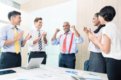 Indian CEO reporting success in business meeting Stock Photos