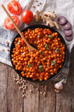 Indian Chana masala with ingredients. Vertical top view Stock Image