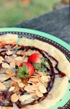 Indian Chapati Breads or roti dough and strawberry fruit. Stock Image