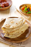 Indian Chapati or chapatti. Chapati or chapatti, Indian dhal and chicken curry, popular Indian food Royalty Free Stock Photo