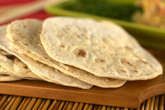 Indian Chapati Flatbread. Indian flatbread called chapati on wooden board (Selective Focus, Focus on the front of the first three chapatis Stock Image