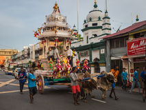 Indian Chariot Pulled by Cows in Penang. A 180 year old chariot pulled by cows in the streets of Penang. The chariot is also used in the Thaipusam  festival Stock Image