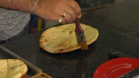 Indian chef prepares indian food. indian bread naan and roti in the oven stock video footage