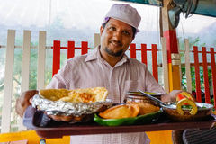 Indian chef serving food Stock Photos