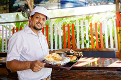 Indian chef serving food Royalty Free Stock Photos