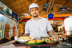 Indian chef serving food Stock Photo