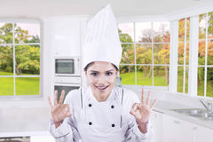 Indian chef shows OK sign in kitchen Royalty Free Stock Photos