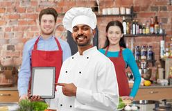 Indian chef with tablet computer at cooking class royalty free stock images