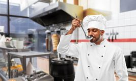 Free Indian Chef Tasting Food From Ladle At Kebab Shop Royalty Free Stock Image - 144987886