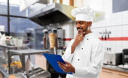 Free Indian Chef With Menu On Clipboard At Kebab Shop Stock Photos - 145198513