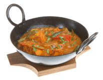 Indian Chicken Curry. Chicken curry in an authentic korai serving dish on a wooden base Stock Image