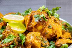 Indian chicken curry with Indian spices stock photos