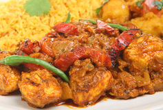 Indian Chicken Curry Meal. Indian chicken jalfrezi with rice and vegetable curry Royalty Free Stock Images
