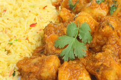Indian Chicken Curry Meal. Chicken Dansak curry with lentils, bombay aloo and pilau rice Royalty Free Stock Photography