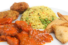Indian Chicken Curry Meal. Chicken curry with special fried rice, onion bhaji and vegetable samosas Stock Photography