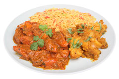 Indian Chicken Curry Meal. Hot Indian chicken curry with Bombay aloo potato curry and rice Royalty Free Stock Images