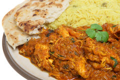 Indian Chicken Curry with Rice & Naan. Indian meal of chicken curry, pilau rice and naan Royalty Free Stock Image