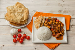 Indian chicken jalfrezi with basmati rice, naan and pappadums. Indian chicken jalfrezi with basmati rice, naan bread and pappadums Stock Photo