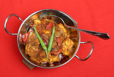 Indian Chicken Jalfrezi Curry. In a stainless steel balti dish Stock Photography