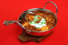Indian Chicken Madras Curry. Garnished with yogurt and chopped coriander Royalty Free Stock Photo