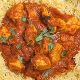 Indian Chicken Madras Curry & Rice. Indian chicken Madras curry with pilau rice Stock Photo