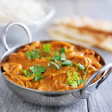 Indian chicken tikka masala in balti dish. Shot in square composition on slate table Royalty Free Stock Photos