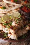 Indian chicken tikka on skewers close-up and naan. vertical Stock Photo
