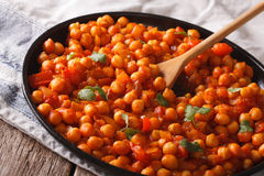 Indian chickpeas in tomato sauce with spices close-up. Horizonta Royalty Free Stock Images