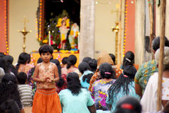 Indian child and christian women. Cute small girl with her family and neighbors during the christian ceremony Stock Photo