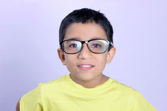 Indian child on eyeglass. Little Indian child wear eyeglass and showing thump up royalty free stock image