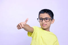 Indian child on eyeglass. Little Indian child wear eyeglass and showing thump up stock photos