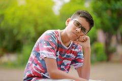 Indian child on eyeglass. And thinking royalty free stock image