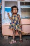 Indian child. KAMALAPURAM, INDIA - 02 FABRUARY 2015: Indian child standing inside a shop on a market close to Hampi Stock Photography