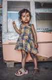 Indian child. KAMALAPURAM, INDIA - 02 FABRUARY 2015: Indian child stands inside a shop on a market close to Hampi. Post-processed with grain, texture and colour Stock Photos