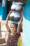 Indian child with pottery. For water supply in rural area. The Economy of India is the tenth largest in the world by nominal GDP Stock Photos