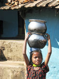 Indian child with pottery. For water supply in rural area. The Economy of India is the tenth largest in the world by nominal GDP Stock Photo