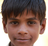 Indian Child. TORDI GARH, INDIA, MARCH 1: An unidentified child inside the village of Tordi Garh, Rajasthan, Northern India on March 1, 2012. The fort and palace Royalty Free Stock Photo