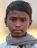 Indian Child. TORDI GARH, INDIA, MARCH 1: An unidentified child inside the village of Tordi Garh, Rajasthan, Northern India on March 1, 2012. The fort and palace Royalty Free Stock Photos