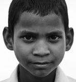 Indian Child. TORDI GARH, INDIA, MARCH 1: An unidentified child inside the village of Tordi Garh, Rajasthan, Northern India on March 1, 2012. The fort and palace Stock Photos