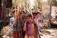 Indian children with cane sugar Stock Images