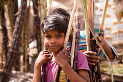 Indian children with cane sugar Royalty Free Stock Photos
