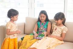 Indian children having fun at home royalty free stock image