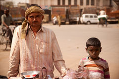Indian  children and man on shopcart of holi Stock Image