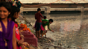 Indian children permorming Chhath pooja at river Stock Image