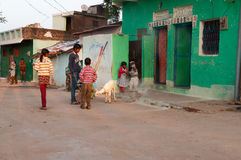 Indian children playing on the street in the village. KHAJURAHO, INDIA - DEC 21, 2014: Unidentified Indian children playing on the street in the village Royalty Free Stock Image