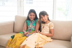 Indian children sitting at home Royalty Free Stock Image