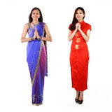 Indian and Chinese woman in traditional clothing. Royalty Free Stock Image