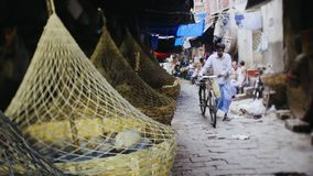 Indian city. Koikata, India - December 2016,street view old indian market with domestic animals shoting on tilt-shift lens stock footage