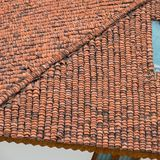 Indian clay roof tile pattern. Clay tile pattern formed on  a rooftop in Tami Nadu, India Royalty Free Stock Photos